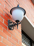Street lamp on brick wall Stock Photo