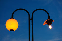 Street lamp with a broken shade Royalty Free Stock Photography