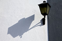 Street lamp a bulb in the  wall arrecife teguise lanzarote spain Royalty Free Stock Photography