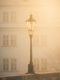 Street lamp on Charles Bridge in foggy morning, Prague, Czech Republic. Sepia image Royalty Free Stock Images