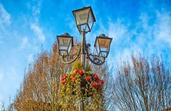 Street lamp with Christmas red balls, Italy royalty free stock image