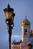Street lamp and church. Behind stock photo