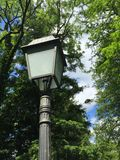 Street lamp in a city park Royalty Free Stock Image
