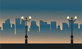 Street lamp with city scenery silhouettes. Vector art vector illustration