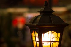 Street lamp close-up with copyspace. Magic lamp with a warm yellow light Royalty Free Stock Images