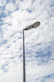 Street lamp with clouds sky Stock Images