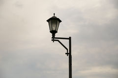 Street lamp in cloudy weather. Alone. clouds Stock Image