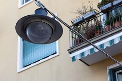 Street lamp for the cty. Old lamp suspended from above on the background of buildings Stock Image