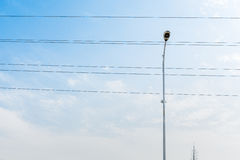 Street lamp. Erect the blue sky under the background of a lamppost and wire Royalty Free Stock Photos