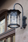 Street lamp on the facade of the house in Munich. The Central part of the city Marienplatz, where the Old and New town Hall, lit with lamps, fastened to the wall Stock Images