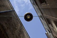 Street lamp and facades Stock Photography