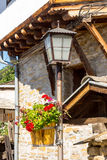 Street lamp and flowers in the old stone Lovech, Bulgaria royalty free stock photo