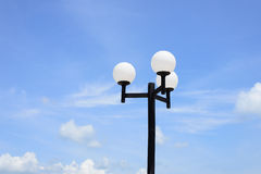 Street lamp in form of white balls Royalty Free Stock Image