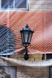 Street lamp on the front of the house to be repaired Stock Photos