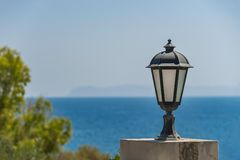 Street lamp in front of the sea, Greece. Street lamp in front of the sea in Greece stock image