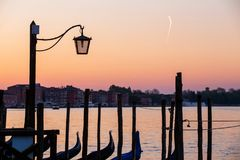 Street lamp and gondolas in Venice, Italy Royalty Free Stock Images