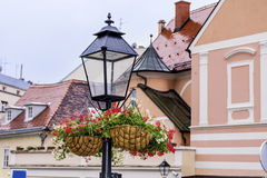 Street Lamp with hanging  Baskets with geraniums Royalty Free Stock Image