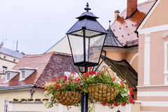 Street Lamp with hanging  Baskets with geraniums Stock Images