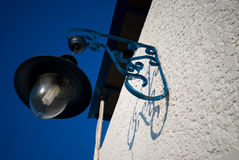 Street lamp hanging on a wall Royalty Free Stock Image