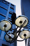 street lamp with high rise building Royalty Free Stock Images