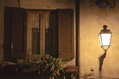 Street lamp illuminates wall Stock Images