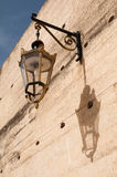 Street lamp. And its shadow on a city wall Stock Image