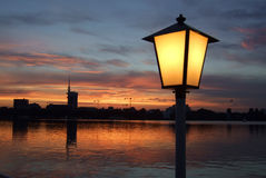 Street lamp and lake at night Royalty Free Stock Images