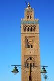 Street lamp   in maroc africa  minaret religion and. In maroc africa      minaret  and the blue     sky Royalty Free Stock Photo