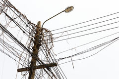 Street lamp with messy cable and dry vine / creepe Stock Image