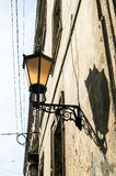 Street Lamp Mounted On Old Wall In Lviv, Ukraine Stock Photo