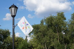 Street lamp and multi-colored flag Royalty Free Stock Photography