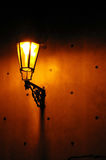 Street lamp at night. Street lamp lighting a piece of  wall at night Stock Image