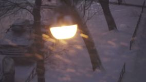 Street lamp at night during a snowstorm.  stock footage
