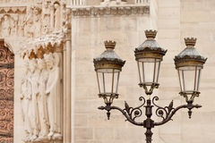 Street lamp by Notre Dame cathedral Stock Photos