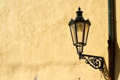 Street lamp on the orange wall royalty free stock images