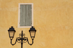 Street Lamp and an orange wall Royalty Free Stock Image