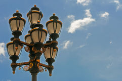 Street lamp with ornament. Street  lamp with ornament and  blue sky in background Royalty Free Stock Images