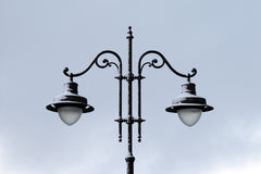 Street lamp on pole in winter with snow Stock Image