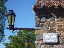 Street lamp. And Portuguese tiled street sign in Colonia Del Sacramento Uruguay Royalty Free Stock Photography