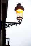 Street lamp post with light turn on during day time depicts concept of energy waste Royalty Free Stock Image
