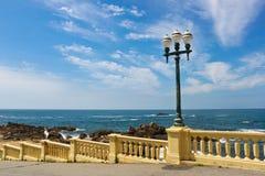 Street lamp on a promenade near ocean Stock Photo