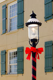 Street lamp with a red ribbon Royalty Free Stock Image