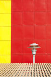 Street lamp red and yellow wall, background Royalty Free Stock Photo