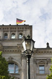 Street lamp with Reichstag building and German flag Stock Image