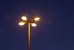 Street lamp at the road junction during blue hours Royalty Free Stock Photography