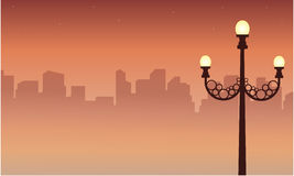 Street lamp scenery with city silhouettes. Vector illustration royalty free illustration