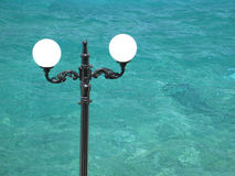 Street Lamp and the Sea. A street lamp, having the sea as a background stock images