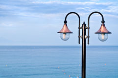 Street lamp and sea Royalty Free Stock Image