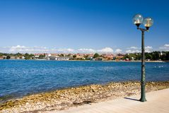 Street lamp on the sea-front of Porec Royalty Free Stock Photo
