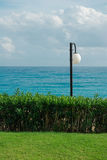 Street lamp by the sea Royalty Free Stock Photos